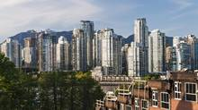 Vancouver's real estate scene; Fairview slopes townhouses under construction (foreground) and high-rise condo towers in the city's Yaletown district, May 3, 2013. (Bayne Stanley/The Canadian Press)