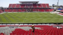 A worker walks through the east stands at Toronto FC's BMO Field on Thursday, May 7, 2015. (Chris Young/THE CANADIAN PRESS)
