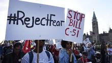 People protest against Bill C-51, the government's anti-terror legislation, in Ottawa. (Justin Tang/The Canadian Press)