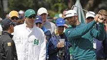 Dustin Johnson quit the Masters a minute or so before he was to start it on Thursday because of a back injury that the golfer sustained on Wednesday after falling down the stairs at his Augusta rental house. (Mike Segar/Reuters)