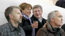Canadian Prime Minister Stephen Harper and B.C. Premier Christy Clark look on as Clark's 10-year-old son Hamish plays during a minor league hockey game in Vancouver, Thursday Jan. 12, 2012. (Jeff Vinnick/Jeff Vinnick/THE CANADIAN PRESS)