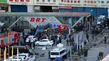 Security personnel gather near the scene of an explosion outside the Urumqi South Railway Station in Urumqi in northwest China's Xinjiang Uygur Autonomous Region on Wednesday April 30, 2014. An explosion shook the railway station in China's restive far-western region of Xinjiang, injuring many people as President Xi Jinping wrapped up a four-day visit to the area, state media said Wednesday. (AP)