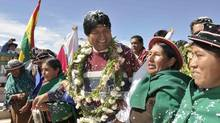 Bolivia's President Evo Morales (centre), who faces elections in 2014, is likely to step up attempts to empower the indigenous majority to take a bigger role in the management of natural resources. (HANDOUT/REUTERS)