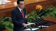 Chinese Premier Li Keqiang delivers a work report during the opening session of the National People's Congress at the Great Hall of the People in Beijing Thursday, March 5, 2015. (Andy Wong/Associated Press)