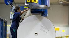 An employee opens a fresh roll of newsprint paper at the Toronto Star printing plant on Wednesday, July 6, 2011. The newspaper company is expected to announce on Friday that it intends to close the Vaughan, Ont. printing plant. (Brent Lewin/Bloomberg)