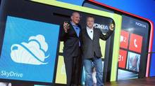 Microsoft CEO Steve Ballmer, left, and Nokia President and CEO Stephen Elop unveil the Nokia Lumia 920 and Nokia Lumia 820, Nokia's first devices for Windows Phone 8, at a press event in New York, Wednesday, Sept. 5, 2012. (Diane Bondareff/AP)