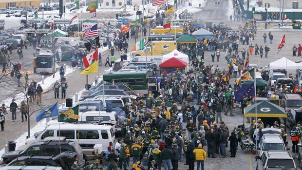 Fans tailgate at Lambeau Field before an NFL wild-card playoff football game between the Green Bay Packers and the Minnesota Vikings Saturday, Jan. 5, 2013, in Green Bay, Wis. (Mike Roemer/AP)
