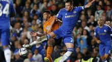 Chelsea's captain John Terry, right, competes for the ball with Wolverhampton Wanderers' David Davis during the English League Cup match between Chelsea and Wolverhampton Wanderers at Stamford Bridge stadium in London, Tuesday, Sept. 25, 2012. (Matt Dunham/AP)