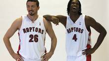 Toronto Raptors Chris Bosh (right) and Hedo Turkoglu laugh as they pose for a photo on Raptors Media Day in Toronto on Monday September 28, 2009. Turkoglu recently told a Turkish TV station that he is actively trying to be released from the Raptors. (Frank Gunn/THE CANADIAN PRESS)