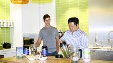 Mmm, spinach. Brendan Brazier (left) and Charles Change whip up a Vega shake. (JENNILEE MARIGOMEN for Report on Business magazine)