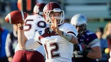 McMaster Marauders quarterback Kyle Quinlan surpassed a school record with his 60th career passing touchdown in Saturday's 43-0 win over Laurier. (file photo) (DAVE CHIDLEY/THE CANADIAN PRESS)