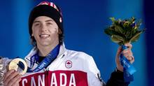 Canadian Mark McMorrisreceives his bronze medal for snowboard slopestyle at the medal ceremonies during the 2014 Sochi Winter Olympics in Sochi, Russia on Feb. 8. (Nathan Denette/Canadian Press)