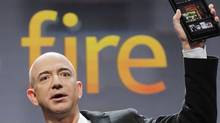 Jeff Bezos, chairman and CEO of Amazon.com, introduces the Kindle Fire tablet computer in September. (Mark Lennihan/AP)