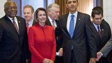 U.S. President Barack Obama stands with Democratic leaders including House Majority Whip James Clyburn, left, and Speaker of the House Nancy Pelosi, after a caucus meeting on Capitol Hill on Saturday, November 7, 2009. (Brendan Smialowski/2009 Getty Images)