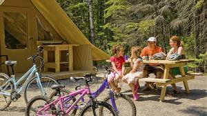 Huttopia tents can be found in Pointe-Taillon park in Quebec.