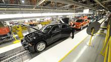 Chrysler employees assemble cars at the plant in Brampton, Ont. The facility makes full-sized sedans, which are losing market share in North America to fuel-efficient compact cars. (Kevin Van Paassen/Kevin Van Paassen/The Globe and Mail)