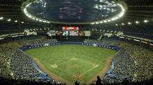 Baeball fans fill Olympic Stadium to watch the Montreal Expos play their final home game against the Florida Marlins in Montreal, Wednesday, Sept. 29, 2004. (Associated Press)