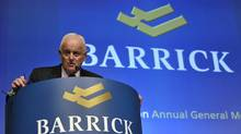 Barrick Gold Corp. chairman Peter Munk speaks during the annual general meeting of shareholders in Toronto in this May 2, 2012, file photo. Barrick lost more than $3-billion (U.S.) in the fourth quarter after a massive writedown on its African copper business. (MIKE CASSESE/REUTERS)
