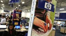 An ad for HP laptops is displayed at a Best Buy store (Justin Sullivan/Getty Images)