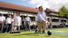 Ontario PC Leader Tim Hudak bowls during a campaign stop at the Stratford Lawn Bowling Club in Stratford, Ont., on Sept. 14, 2011. (Geoff Robins/Geoff Robins/The Canadian Press)