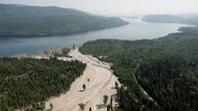 Contents from a tailings pond is pictured going down Hazeltine Creek into Quesnel Lake on August, 5, 2014. (Jonathan Hayward/The Canadian Press)