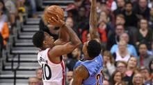 DeMar DeRozan shoots for a basket against Nuggets forward Wilson Chandler on Monday. (Dan Hamilton/USA Today Sports)
