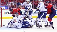 Maple Leafs goalie Frederik Andersen (31) teammates watches the puck bounce away from goal against Washington Capitals right wing Brett Connolly (10) in the third period in game one of the first round of the 2017 Stanley Cup Playoffs at Verizon Center. (Geoff Burke/USA Today Sports)