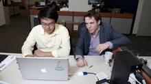 Luke Lockhart, co-founder of PopHire and William Lam, founder of Date Ideas, seen in their downtown Toronto workplace, are two of many recent tech start-ups. (SARAH DEA/SARAH DEA/FOR THE GLOBE AND MAIL)
