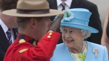 Queen Elizabeth is greeted by an RCMP honor guard as she arrives in Ottawa on Wednesday, June 30, 2010. (Pawel Dwulit/Paul Dwulit/The Canadian Press)
