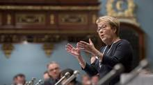Quebec Premier Pauline Marois responds to Opposition questions over the budget speech to be tabled later in the day on Feb. 20, 2014. (JACQUES BOISSINOT/THE CANADIAN PRESS)