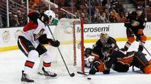Zack Smith #15 of the Ottawa Senators and Hampus Lindholm #47, Clayton Stoner #3 and Frederik Andersen #31 of the Anaheim Ducks battle for a loose puck in front of the net during the second period of a game at Honda Center on January 13, 2016 in Anaheim, California. (Sean M. Haffey/Getty Images)