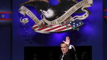 U.S. Republican presidential candidate Mitt Romney waves at the end of the final U.S. presidential debate in Boca Raton, Fla., Oct. 22, 2012. (JIM YOUNG/REUTERS)