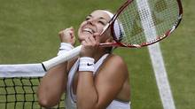 Sabine Lisicki of Germany, the new favourite, reacts after ousting Kaia Kanepi of Estonia to earn a semi-final berth. (Anja Niedringhaus/AP)