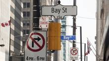 Bay Street signs are seen in the heart of the financial district in Toronto, Aug. 17, 2009.. (© Mark Blinch / Reuters)