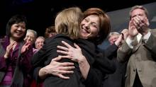 Premier-designate Christy Clark hugs her nine-year-old son Hamish at the BC Liberal convention in Vancouver after winning the leadership on Feb. 26, 2011. (JOHN LEHMANN/JOHN LEHMANN/THE GLOBE AND MAIL)