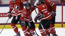 Canada's Vicki Bendus (28) celebrates her goal against Finland with teammates Courtney Birchard (11), Gillian Apps (10) and Brigette Lacquette (4) during the first period of a Four Nations Cup women's championship hockey game on Saturday, Nov. 9, 2013, in Lake Placid, N.Y. (Mike Groll/AP)