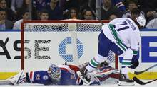 NEW YORK, NY - NOVEMBER 08: Loui Eriksson #21 of the Vancouver Canucks scores at 15:18 of the second period against Antti Raanta #32 of the New York Rangers at Madison Square Garden on November 8, 2016 in New York City. (Bruce Bennett/Getty Images)