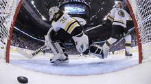 Boston Bruins goalie Tim Thomas reacts to the game-winning goal by Vancouver Canucks Alex Burrows (not seen) during overtime in Game 2 of the NHL Stanley Cup hockey playoff in Vancouver on Saturday. (POOL)