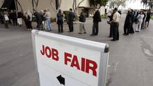 Hundreds of people wait in line at a job fair presented by Jobs & Careers Newspaper and Job Fairs in San Mateo, Calif. (Paul Sakuma/AP)