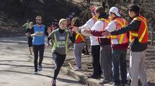 Volunteers in Toronto shout out support to participants in the Harry's Spring Run-Off to Conquer Prostate Cancer. A recent study suggests that about 13 million people in Canada do volunteer work. (Philip Cheung For The Globe and Mail)