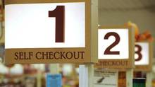 In this Sept. 23, 2011 photo, a row of self checkout lines are available at a Big Y supermarket in Manchester, Conn. A growing number of supermarket chains are bagging their self-serve checkout lanes, saying they can offer better customer service when clerks help shoppers directly. Big Y Foods, which has more than 60 southern New England locations, recently became the latest to announce it's phasing them out. (Jessica Hill/(AP Photo/Jessica Hill))