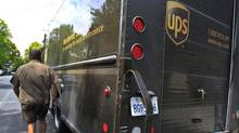 In this April 25, 2011 photo, United Parcel Service (UPS) driver Albert Palafox finishes his deliveries in Palo Alto, Calif. UPS lowered its earnings expectations for the year on Tuesday as economic weakness and uncertainty persist around the globe. The world's largest package delivery company said its customers are worried about the global economy weakening in the second half of the year. (Paul Sakuma/AP)