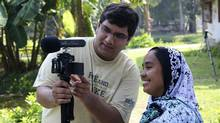 Shawn Ahmed, left, with health worker Afia Afroze in southern Bangladesh (Imteaz Mannan)