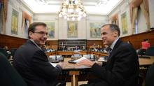 Senior deputy governor Tiff Macklem, left, and Bank of Canada Governor Mark Carney and appear at a finance committee hearing. (Sean Kilpatrick/CP)