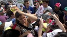 Milos Raonic signs autographs for fans in Rogers Cup tennis action in Toronto (Frank Gunn/THE CANADIAN PRESS)