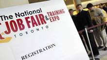 Job seekers line up at an employment fair in Toronto in 2012. The pattern of a stall in growth for an extended period lasting at least four months, bracketed at both ends by strong gains in employment, happens on a regular basis. (J.P. MOCZULSKI FOR THE GLOBE AND MAIL)