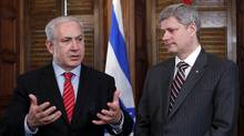 Israeli Prime Minister Benjamin Netanyahu, speaks during a meeting with Canadian Prime Minister Stephen Harper in Harper's office on Parliament Hill in Ottawa on May 31, 2010. (CHRIS WATTIE/Chris Wattie/Reuters)