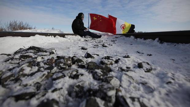 Idle No More demonstrators block a CN east-west track just west of Portage La Prairie, Man., on Jan. 16, 2013.