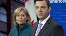 Ontario PC Leader Tim Hudak, right, and Christine Elliott speak to reporters at Queen's Park in Toronto on Thursday, Feb. 7, 2013. (FRANK GUNN/THE CANADIAN PRESS)