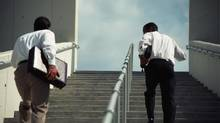 Businessmen moving upstairs, rear view thinkstock (John Foxx/Getty Images)